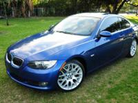 THIS RARE MONTEGO BLUE BMW 328i SPORT COUP IS