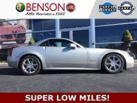 One of a kind! Incredible miles! Leather interior,