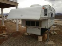 Great Camper in good condition. Fits a long bed pickup.