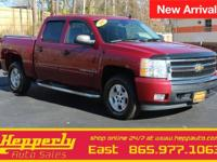 This 2007 Chevrolet Silverado 1500 LT in Sport Red