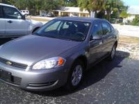 GRAY IN COLOR. LOW MILES, ALUMINUM WHEELS, FULL POWER,
