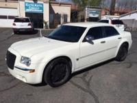 This Chrysler 300 is a must see must own, it has a V8