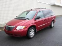You are looking at a Red, 2007 Chrysler Town and