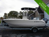 The Cobia 19 Bay Console is a fishing boat made with