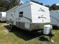 A 29' Travel Trailer with one slide-out. A 30 Day