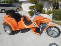 This is a beautifull trike with new Orange Pearl paint.