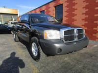 From work to weekends, this Black 2007 Dodge Dakota ST