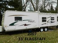 2007 33' Flagstaff pull behind camper w/slide out. Used