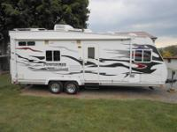 This is a Hyperlite trailer that can be towed with a