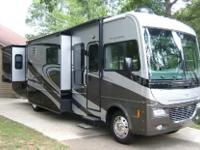 This Class A Recreational Vehicle has 27,566 miles and