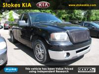 Exterior Color: black clearcoat, Body: Regular Cab