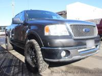 This 2007 Ford F150 SuperCrew Cab Lariat Pickup 4D 5