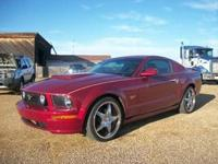 Burgundy exterior with tan leather bucket seats, 4.6