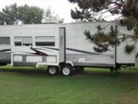 GREAT TO EXCELLENT CONDITION 2007 27 FOOT FOREST RIVER