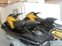 2 2007 GP1300r GP1300 jet skis black and gold these