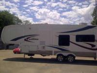2007 Heartland Sundance. This 34 Foot Camper is in