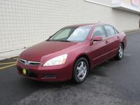 You are looking at a Red, 2007  Honda Accord Hybrid V6.