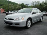 Options Included: Curtain Air Bags, 6 Disc CD Changer,