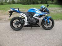 2007 Honda CBR 600 RR in a stunning blue and silver.