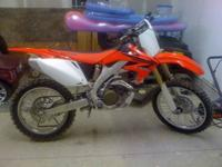 like new dirt bike it has less than 15 hours on