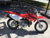 THIS IS A HONDA CRF 70 ,, THIS DIRT BIKE IS IN EXALLENT
