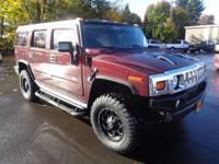 This 2007 Hummer H2 SUV, has a great Purple exterior,