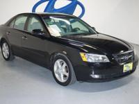 CARFAX 1-Owner. Limited trim. Heated Leather Seats, CD