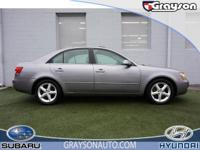 CARFAX 1-Owner. Heated Leather Seats, CD Player, Alloy