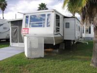 36 foot travel trailer with 10x24 screen room with