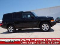 This is one Sharp Jeep Commander Sport 2WD!! It was