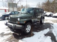 This SAHARA Jeep Wrangler comes equipped VERY WELL with