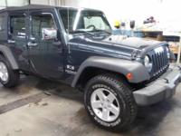This is a nice, local,women driven 4x4 4 door Jeep