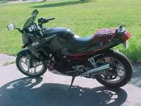 2007 NINJA - COLOR BLACK WITH RED FLAMES. HAS A FOUR