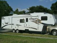 This is a 2007 Keystone Cougar 310SRX side load