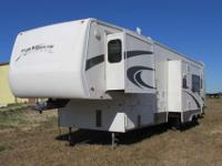 A 38' Fifth Wheel Toy Hauler with a power garage door