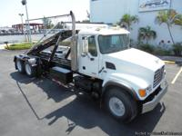 Stock #61426 **Low Miles** **Extendable Hoist Tail**
