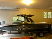 This functional 23' v- drive wakeboarding boat produces