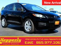 This 2007 Mazda CX-7 Touring in Black features. ABS