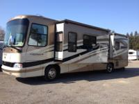 36' quad slide, 14,000 miles, Cherry cabinets, 325 HP