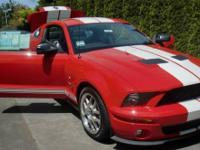 This is a 2007 Shelby Cobra GT500. The car is almost