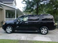 This is a 2007 Nissan Armada SE in Black with charcoal