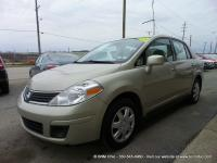 CARFAX 1 OWNER 2007 Nissan Versa 1.8 S. Gold beauty!!!