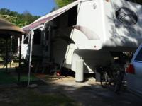 4 slide outs. Great condition. New awning, new air
