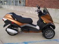 The PIAGGIO MP3 is equally comfortable when going of