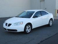 You are looking at a white, 2007 Pontiac G6. This is a