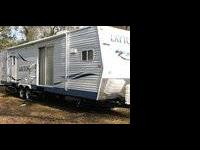 32 ft travel trailer with 2 slideouts, King size bed,