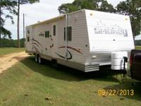 2007 Smokey, Model # 31SDBH, front queen bed, sofa and