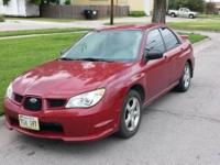 2007 Subaru Impeza. Has 120k miles, automatic