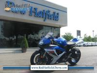 This Bright Blue Suzuki GSXR 600 Sport Bike is fast,