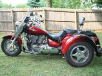 For sale is a 2007 Suzuki C90 trike with the Lehman
